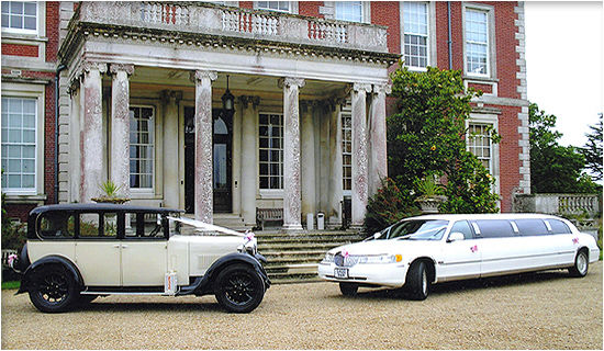 Opposites attract! 1928 Vintage Hillman and our millenium Super Stretch Limousine.