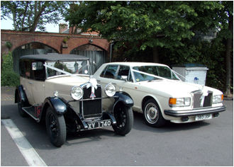 The cream Silver Spirit accompanied by our Vintage Hillman