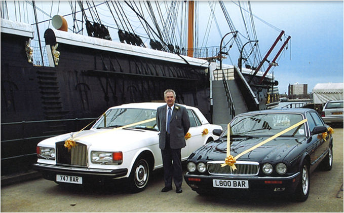 Rolls Royce Silver Spirit and a Jaguar X300 outside HMS Warrior, Portsmouth